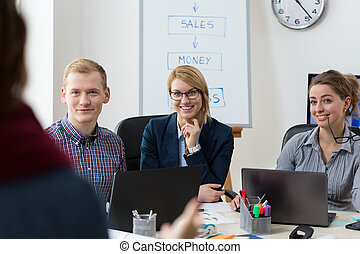 Businesspeople discussing with client - Horizontal view of ...