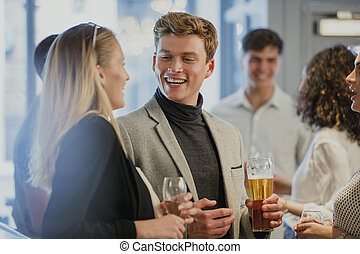 Businesspeople Enjoying After-Work Drinks
