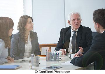 Businesspeople establishing business strategy