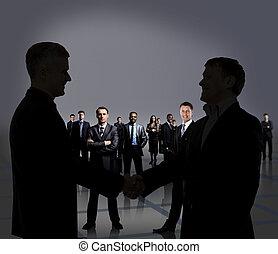 Businesspeople figures. Handshake.