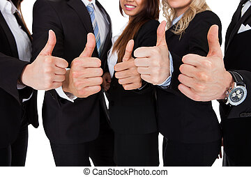 Businesspeople Gesturing Thumbs Up