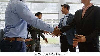 Businesspeople greeting each other in office 4k