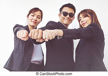 Businesspeople hands in fists, business and teamwork concept