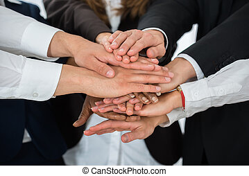Businesspeople Hands Stacking Together - Close-up Of...