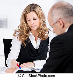 Businesspeople having a serious discussion - Two...