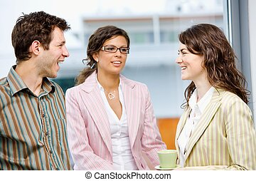 Businesspeople having coffee break - Happy young business...