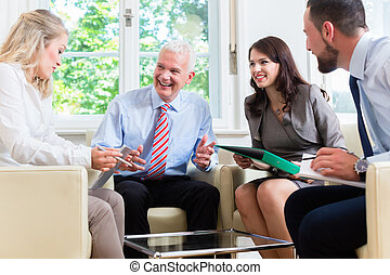 Businesspeople having discussion in office