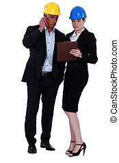 Businesspeople holding a clipboard