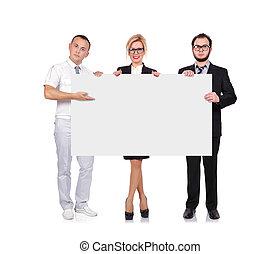 businesspeople holding blackboard