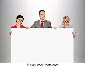 businesspeople holding blank poster