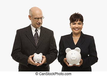 Businesspeople holding piggybanks. - Caucasian middle-aged...