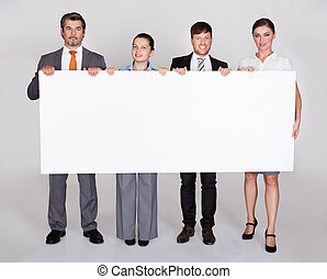 Businesspeople Holding Placard