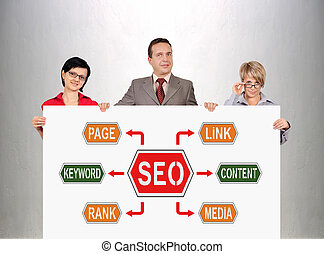 seo scheme - businesspeople holding poster with seo scheme