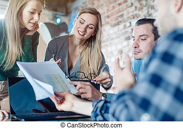 Businesspeople in a startup business discussing financials