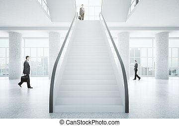 Businesspeople in business center interior - Businesspeople ...