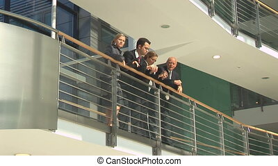businesspeople in discussion on balcony wide.mov
