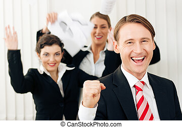 Business people having a lot of fun and letting it show, maybe they are lawyers having won a favorable ruling, maybe they just got notice of their promotion