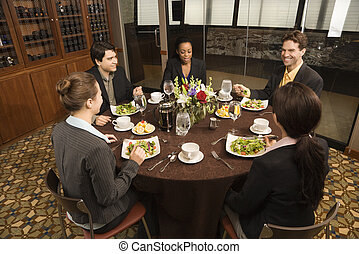 Businesspeople in restaurant. - High angle of diverse group ...