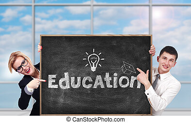 businesspeople in room holding chalk board with education concept