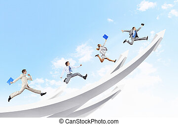Businesspeople jumping - Young businesspeople jumping on...