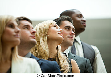 Businesspeople looking up in a stairs