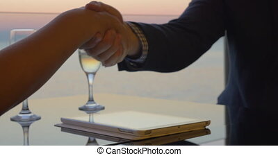 Businesspeople making a deal and drinking wine