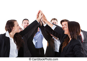 Businesspeople making high five gesture over white...