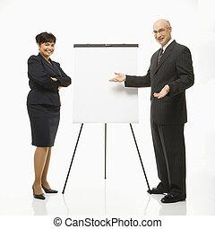 Businesspeople making presentation.
