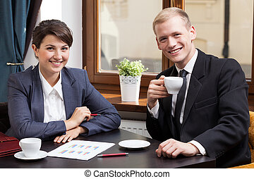 Businesspeople on business meeting in cafe