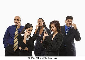 Businesspeople on cellphones. - Multi-ethnic business group...
