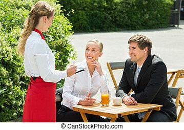 Businesspeople Ordering Food