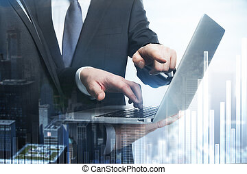 Businesspeople pointing at laptop