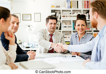 Businesspeople shakind hands