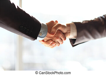Businesspeople shaking hands - Business people shaking...
