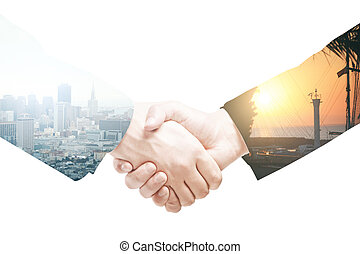 Businesspeople shaking hands on abstract light background....
