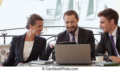 Businesspeople sitting at restaurant