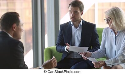 Businesspeople sitting office room having serious conflict ...