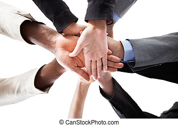 Businesspeople Stacking Hands - Low Angle View Of ...