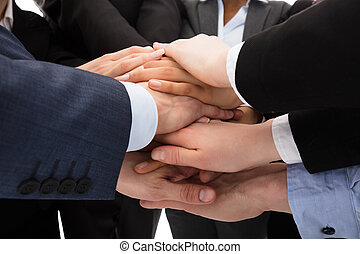 Businesspeople Stacking Hands - Close-up Photo Of...