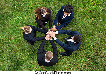 Businesspeople Stacking Their Hands - Elevated View Of...