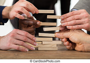 Businesspeople Stacking Wooden Blocks