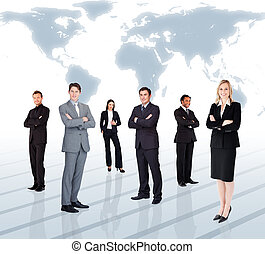Businesspeople standing against world map