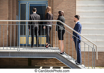 Businesspeople Standing Outside Office Building