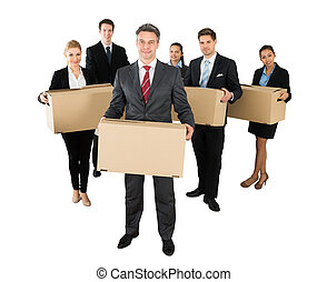 Businesspeople Standing With Cardboard Boxes