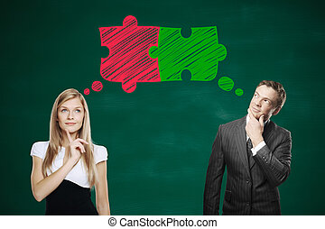 Businesspeople thinking about puzzle pieces