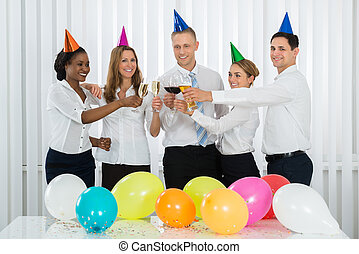 Businesspeople Toasting With Champagne At The Party