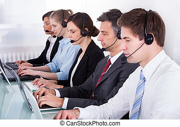 Businesspeople Using On Laptop