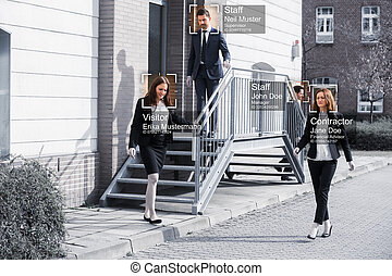 Businesspeople Walking Outside Office Building