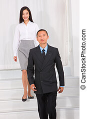 Businesspeople walking stairs