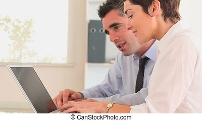 Businesspeople with a laptop